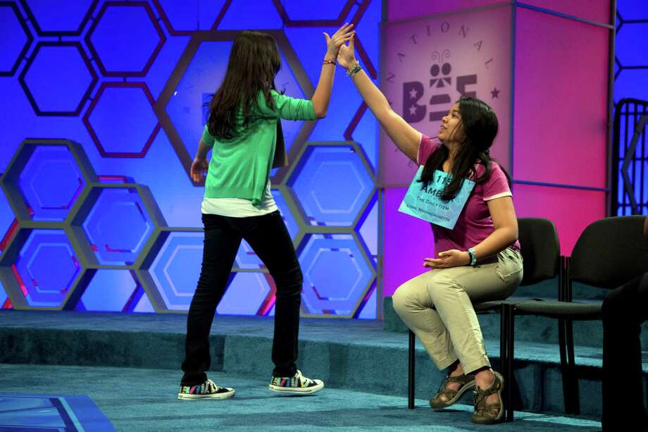"Vismaya Kharkar, 14, of Bountiful, Utah, left, is congratulated by Amber Born, 14 of Marblehead, Mass., after spelling the word ""agelicism"" correctly during the semifinal round of the National Spelling Bee on Thursday, May 30, 2013, in Oxon Hill, Md. Photo: Evan Vucci, Associated Press / AP"