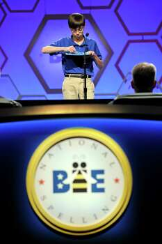 "Jonathan Caldwell, 13, of Hendersonville, Tenn., spells ""pergameneous"" during the semi-final round of the Scripps National Spelling Bee in Oxon Hill, Md., Thursday, May 30, 2013. Photo: Cliff Owen, Associated Press / FR170079 AP"