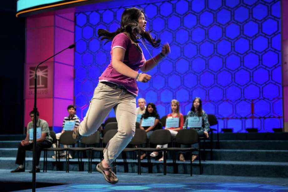 Amber Born, representing Massachusetts, celebrates after spelling a word correctly during the semifinal round at the Scripps National Spelling Bee May 30, 2013 in National Harbor, Maryland. Photo: BRENDAN SMIALOWSKI, AFP/Getty Images / Brendan SMIALOWSKI