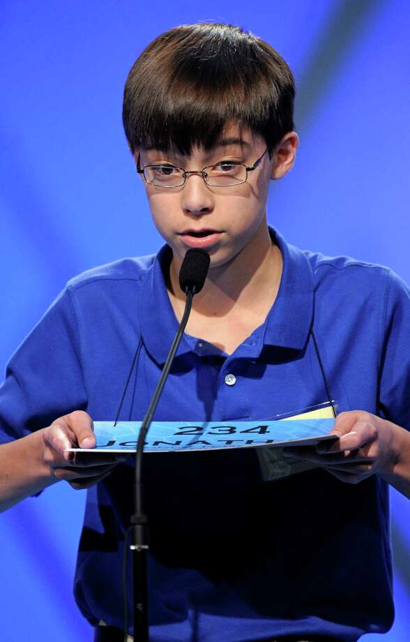 "Jonathan Caldwell, 13, of Hendersonville, Tenn., spells ""persiflage"" during the semifinal round of the Scripps National Spelling Bee in Oxon Hill, Md., Thursday, May 30, 2013. Photo: Cliff Owen, Associated Press / FR170079 AP"
