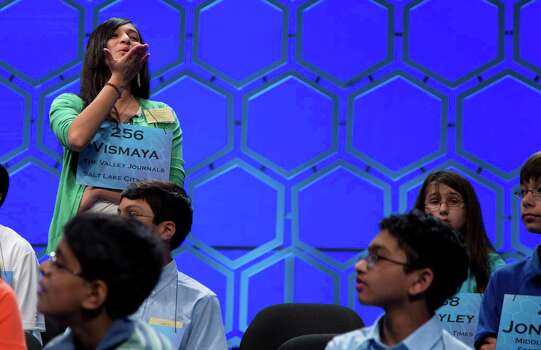 Vismaya Kharkar, 14, of Bountiful, Utah blows a kiss to her family during a break in the semifinal round of the National Spelling Bee, Thursday, May 30, 2013, in Oxon Hill, Md. Photo: Evan Vucci, Associated Press / AP