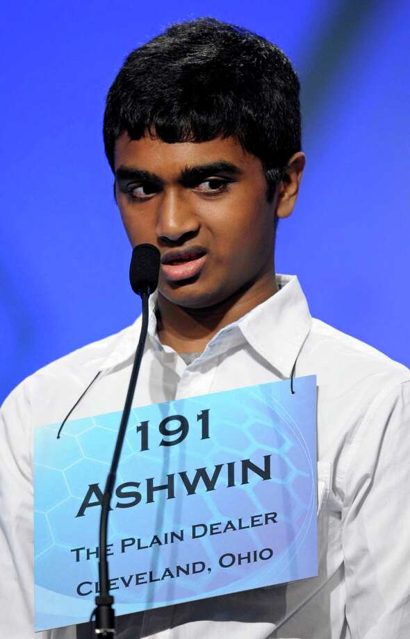 "Ashwin Veeramani, 13, of North Royalton, Ohio, incorrectly spells ""amimia"" during the semifinal round of the Scripps National Spelling Bee in Oxon Hill, Md., Thursday, May 30, 2013. Photo: Cliff Owen, Associated Press / FR170079 AP"