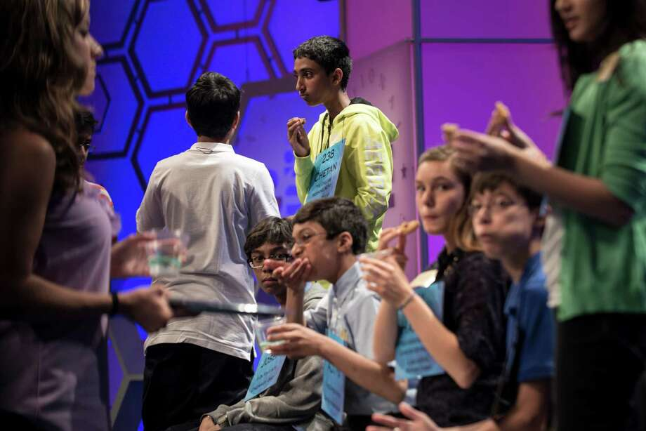 Contestants eat a snack during a commercial break during the semifinal round at the Scripps National Spelling Bee on May 30, 2013 in National Harbor, Maryland. Photo: BRENDAN SMIALOWSKI, AFP/Getty Images / Brendan SMIALOWSKI