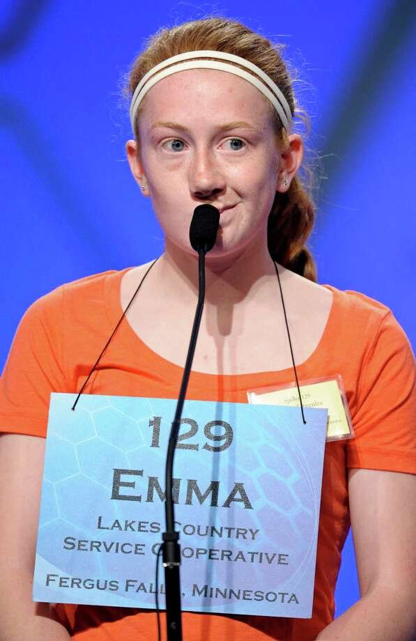 "Emma Greenlee, 14 of Aurora, Minn., spells ""joculator"" during the semifinal round of the Scripps National Spelling Bee in Oxon Hill, Md., Thursday, May 30, 2013. Photo: Cliff Owen, Associated Press / FR170079 AP"