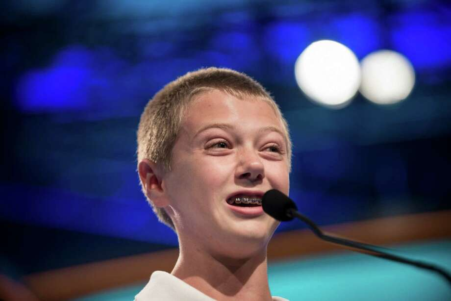 Christopher O'Connor, representing Arizona, spells a word during the semifinal round at the Scripps National Spelling Bee on May 30, 2013 in National Harbor, Maryland. Photo: BRENDAN SMIALOWSKI, AFP/Getty Images / Brendan SMIALOWSKI