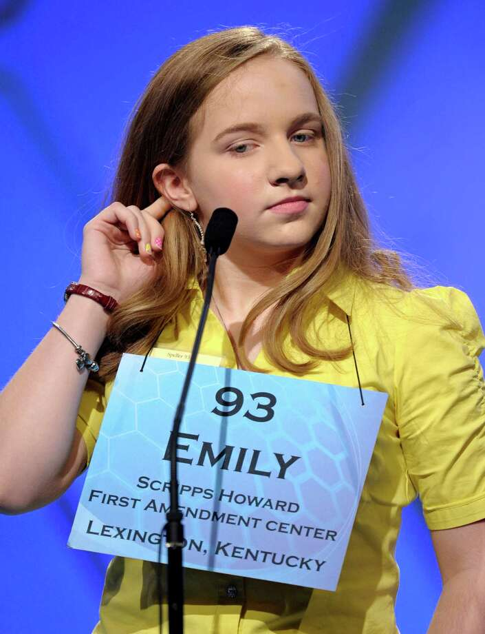 "Emily Keaton, 14, of Pikeville, Ky., spells ""encephalitis"" during the semifinal round of the Scripps National Spelling Bee in Oxon Hill, Md., Thursday, May 30, 2013. Photo: Cliff Owen, Associated Press / FR170079 AP"