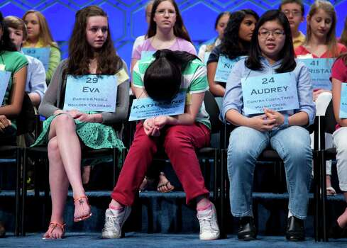 Katharine Wang, 11, of Beijing, China, center, gathers herself before the start of the semifinal round of the National Spelling Bee, Thursday, May 30, 2013, in Oxon Hill, Md. From left are, Eva Kitlen of Niwot, Colo., Wang, and Audrey Bantug, 13, of San Ramon, Calif. Photo: Evan Vucci, Associated Press / AP