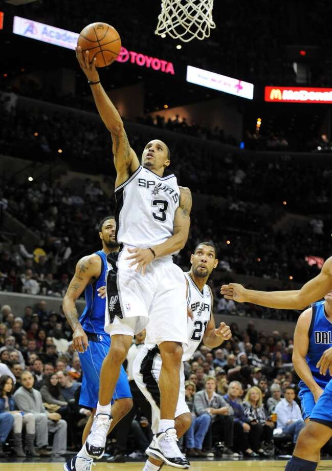 Spurs point guard George Hill (3) puts up a lay-up against the Dallas Mavericks during a NBA basketball game between the Spurs and the Dallas Mavericks at the AT&T Center in on November 26, 2010.