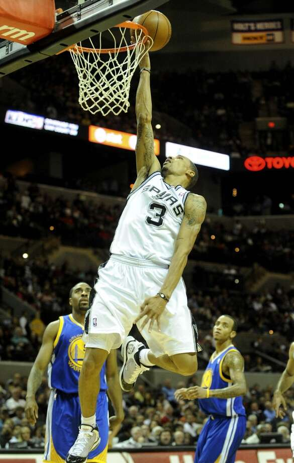 George Hill of the Spurs scores on a breakaway during first-half NBA action against the Golden State Warriors at the AT&T Center on Wednesday, Dec. 8, 2010.
