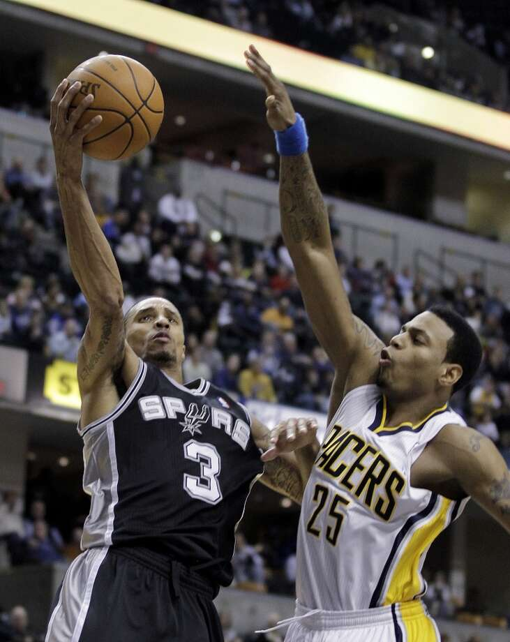 Spurs guard George Hill (3) puts up a shot against Indiana Pacers' Brandon Rush during the second quarter of an NBA basketball game in Indianapolis, Friday, Jan. 7, 2011.