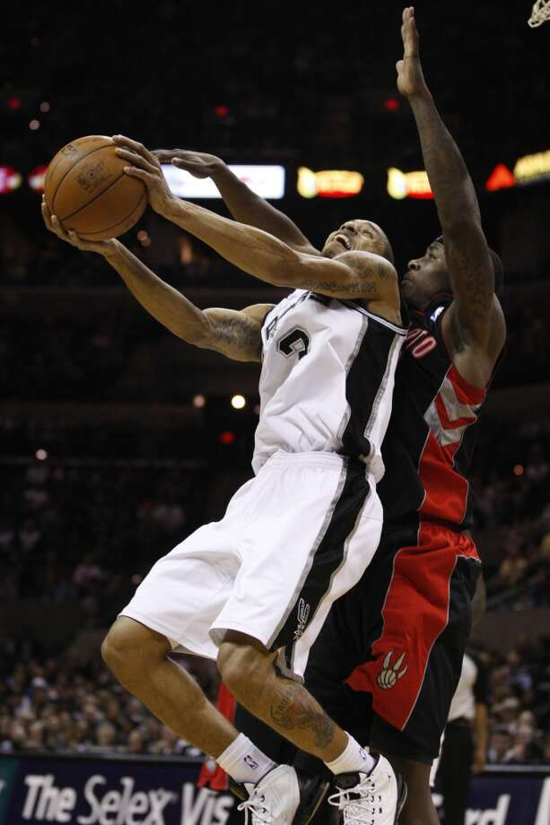 Spurs guard George Hill tries to get by Toronto Raptors 