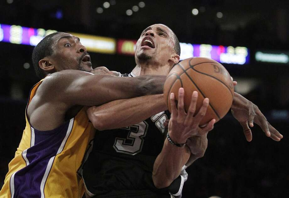 Lakers forward Ron Artest, left, fouls Spurs guard George Hill during the first half of an NBA basketball game in Los Angeles, Thursday, Feb. 3, 2011.