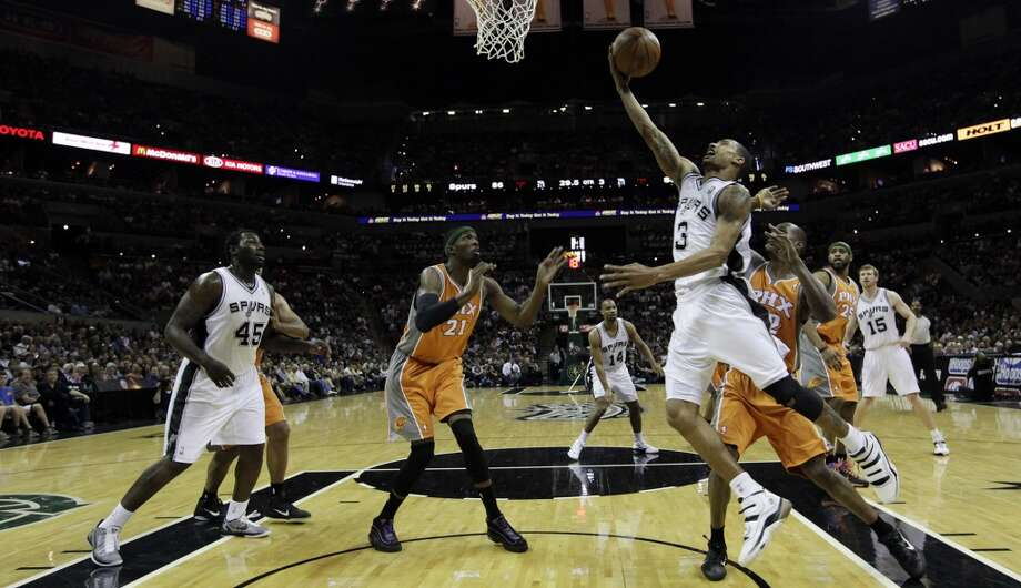 Spurs guard George Hill drives to the goal against the Phoenix Suns during the second half at the AT&T Center, Sunday, April 3, 2011. The Spurs won 114-97. Hill ended up with a game-high of 29 points. JERRY LARA/glara@express-news.net