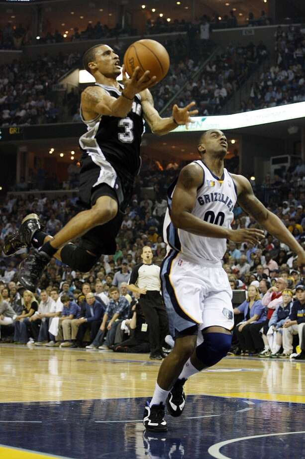 The Spurs' George Hill drives through Memphis Grizzlies Darrell Arthur during the first half in the third game of the Western Conference First Round at FedExForum in Memphis, April 23, 2011.