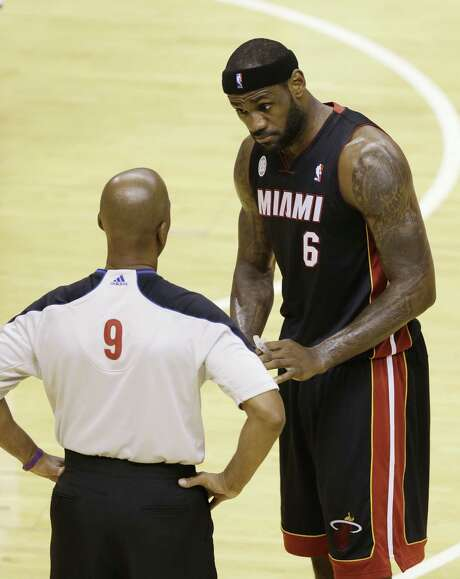 LeBron James was one of three players fined $5,000 for violating the NBA's anti-flopping policy. Photo: AJ Mast / Associated Press