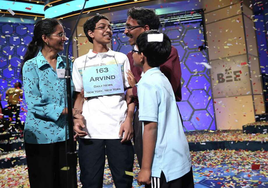 "Arvind Mahankali (2nd L) of Bayside Hills, New York celebrates with his father Srinivas, mother Bhavani, and nine-year-old brother Srinath after the finals of the 2013 Scripps National Spelling Bee May 30, 2013 at Gaylord National Resort and Convention Center in National Harbor, Maryland. Mahankali has won the championship of the annual spelling contest after he correctly spelled the word ""knaidel."" Photo: Alex Wong, Getty Images / 2013 Getty Images"
