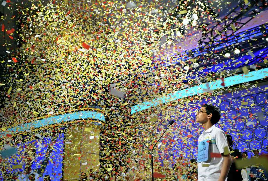 Arvind Mahankali, 13, of Bayside Hills, N.Y. watches confetti fall after he won the Scripps National Spelling Bee in Oxon Hill, Md., Thursday, May 30, 2013. Photo: Cliff Owen, Associated Press / FR170079 AP
