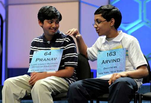Scripps National Spelling Bee champion Arvind Mahankali, 13, of Bayside Hills, N.Y. pats second place finisher Pranav Sivakumar, 13, Tower Lakes, Ill., on the shoulder after Sivakumar incorrectly spelled his final word during the finals. Photo: Cliff Owen, Associated Press / FR170079 AP