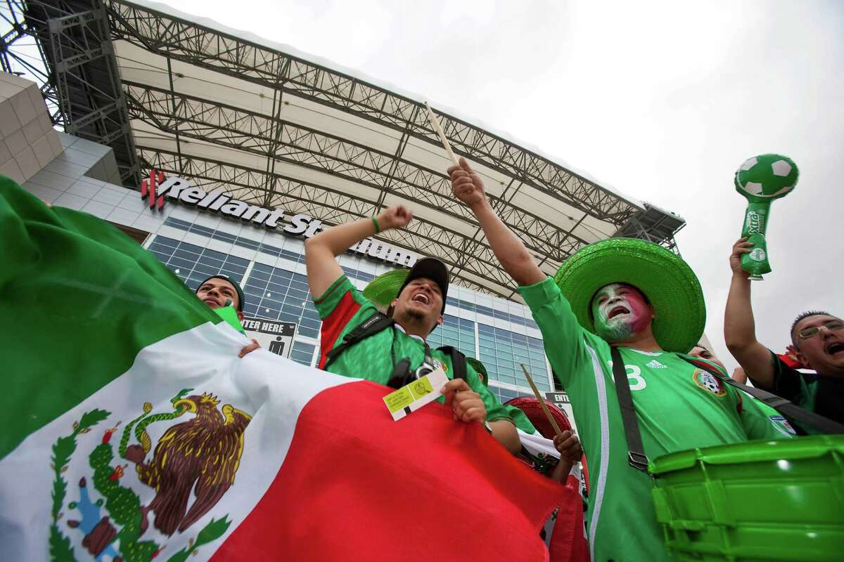 Mexican fans prepare for a 2010 match at Reliant Stadium against Angola that drew 70,099 and resulted in a 1-0 win for El Tri.