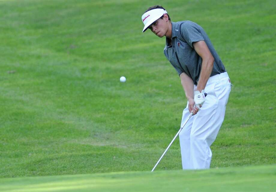 Greenwich's Danny Guise chips onto the green during the FCIAC Boys Golf Championship at at Heritage Village Country Club in Southbury, Conn. on Thursday, May 30, 2013.  Greenwich won with a team score of 312 and Darien placed second. Photo: Tyler Sizemore / The News-Times