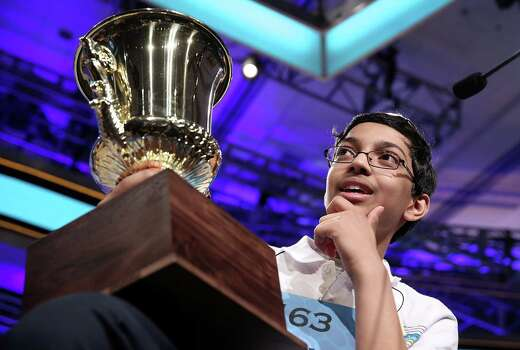 "Arvind Mahankali of Bayside Hills, New York holds his trophy after the finals of the 2013 Scripps National Spelling Bee May 30, 2013 at Gaylord National Resort and Convention Center in National Harbor, Maryland. Mahankali has won the championship of the annual spelling contest after he correctly spelled the word ""knaidel."" Photo: Alex Wong, Getty Images / 2013 Getty Images"