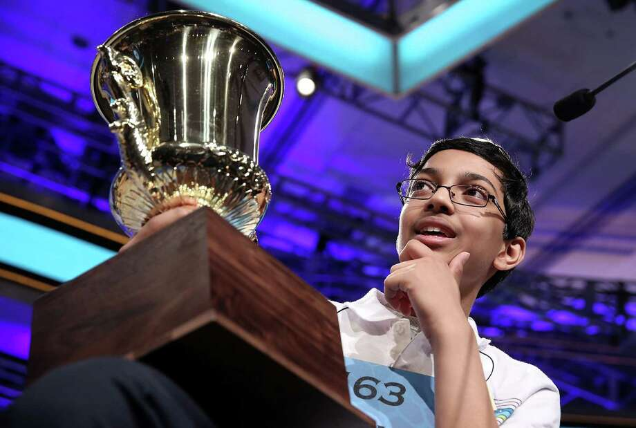 """Arvind Mahankali of Bayside Hills, New York holds his trophy after the finals of the 2013 Scripps National Spelling Bee May 30, 2013 at Gaylord National Resort and Convention Center in National Harbor, Maryland. Mahankali has won the championship of the annual spelling contest after he correctly spelled the word """"knaidel."""" Photo: Alex Wong, Getty Images / 2013 Getty Images"""