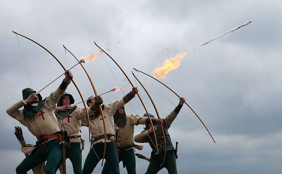 PORTSMOUTH, ENGLAND - MAY 30:  Purbrook Bowmen fire a volley of flaming arrows from Southsea Castle as part of a day of events to mark the opening of the Mary Rose Museum on May 30, 2013 in Portsmouth, England.The Mary Rose was warship of the Tudor navy of King Henry VIII. She sank in the Solent  on 19 July 1545 during an invasion by the French fleet. The wreck of the Mary Rose was rediscovered in 1971 and salvaged in 1982. The Mary Rose Museum in Portsmouth's Historic Dockyard is the new home to warship, and some of the 19,000 artifacts that sank with her. The museum opens 30 years after the hull of Mary Rose was raised from the sea.  (Photo by Peter Macdiarmid/Getty Images) Photo: Peter Macdiarmid, Getty Images