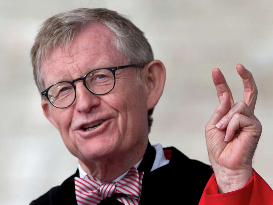 "In this Sunday, May 5, 2013 photo, Ohio State president E. Gordon Gee speaks during the Ohio State University spring commencement in Columbus, Ohio. Gee told a university committee last December that Notre Dame wasn't invited to join the Big Ten because they're not good partners while also jokingly saying that ""those damn Catholics"" can't be trusted. (AP Photo/Carolyn Kaster) Photo: Carolyn Kaster"