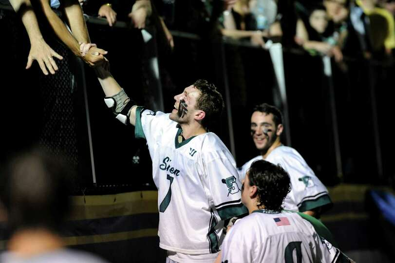 Shenendehowa's Sam Schultz, center, shares his team's victory over Mamaroneck with fans after their