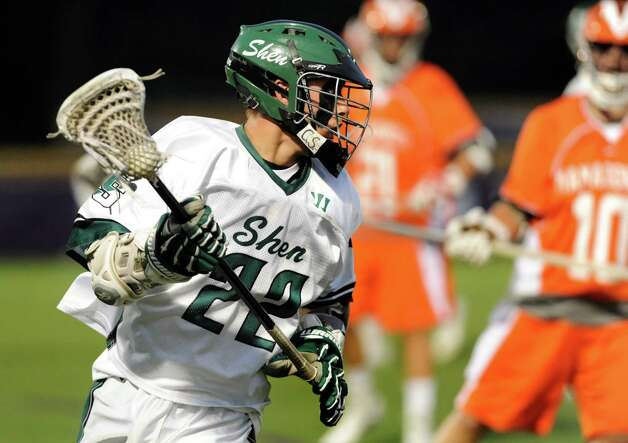 Shenendehowa's Cory Acker, left, controls the ball during their regional outbracket lacrosse game against Mamaroneck on Thursday, May 30, 2013, at UAlbany in Albany, N.Y. (Cindy Schultz / Times Union) Photo: Cindy Schultz / 00022588A