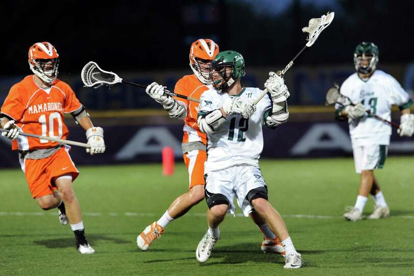 Shenendehowa's Brian Rogers, center, looks to pass during their regional outbracket lacrosse game ag