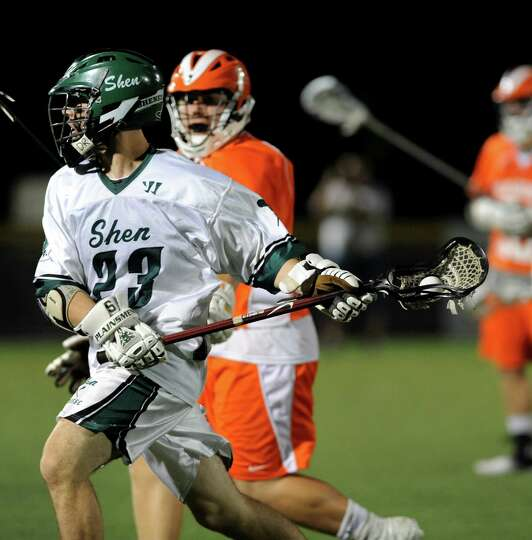 Shenendehowa's Mitch Turiel, left, carries the ball during their regional outbracket lacrosse game a