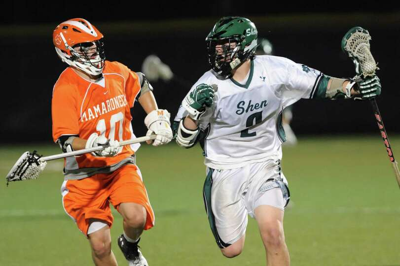 Shenendehowa's D.J. Edick, right, carries the ball as Mamaroneck's Alex Roth defends during their re