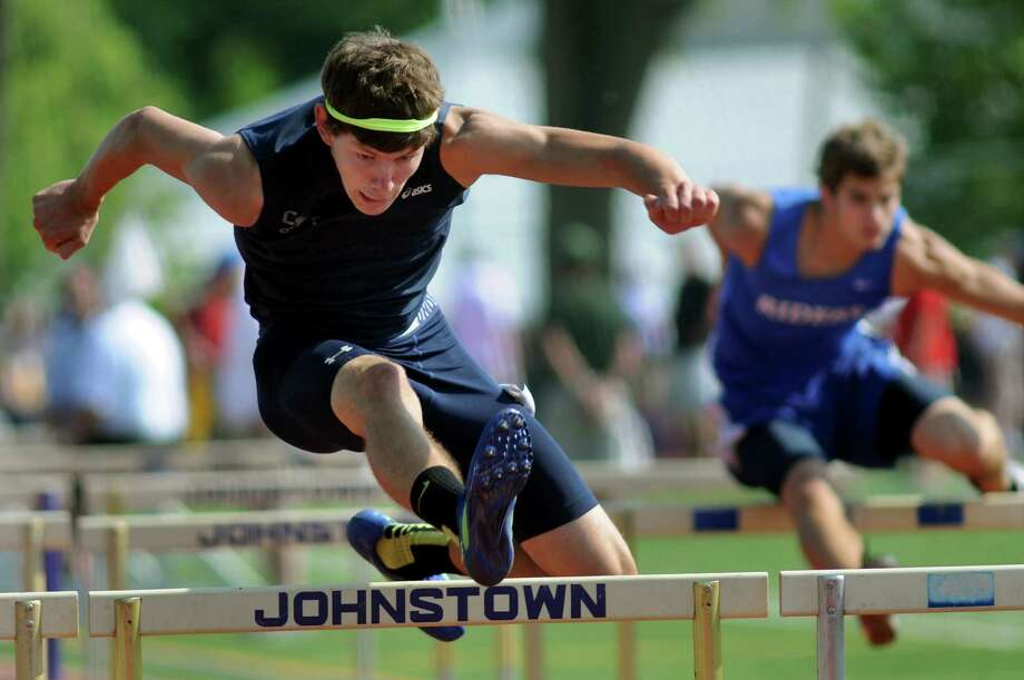 Cobleskill's Zach Haskin, left, jumps the hurdles as part of the pentathlon events during the qualifier meet for state high school track on Thursday, May 30, 2013, at Knox Field in Johnstown, N.Y. (Cindy Schultz / Times Union) Photo: Cindy Schultz / 00022629A