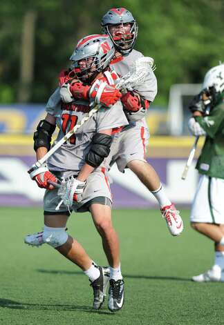 Niskayuna's Lucas Maloney jumps on the back of John Prendergast after John scores in the last minutes of the class B regional semifinal lacrosse game against Yorktown at UAlbany on Thursday, May 30, 2013 in Albany, N.Y.  (Lori Van Buren / Times Union) Photo: Lori Van Buren / 00022587A