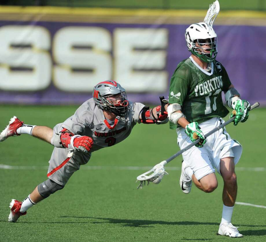 Niskayuna's Lucas Maloney flies through the air to defend Yorktown's Austin Fusco during the class B regional semifinal lacrosse game at UAlbany on Thursday, May 30, 2013 in Albany, N.Y.  (Lori Van Buren / Times Union) Photo: Lori Van Buren / 00022587A