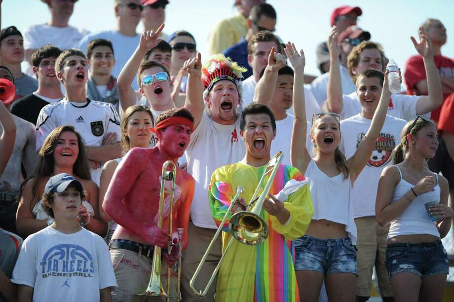 Niskayuna fans cheer for their winning team during the class B regional semifinal lacrosse game against Yorktown at UAlbany on Thursday, May 30, 2013 in Albany, N.Y.  (Lori Van Buren / Times Union) Photo: Lori Van Buren / 00022587A