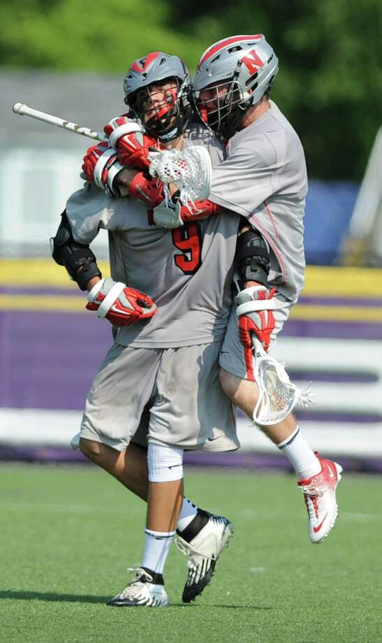 Niskayuna's Lucas Maloney jumps on the back of Luke Goldstock after Luke scores during the class B regional semifinal lacrosse game against Yorktown at UAlbany on Thursday, May 30, 2013 in Albany, N.Y.  (Lori Van Buren / Times Union) Photo: Lori Van Buren / 00022587A