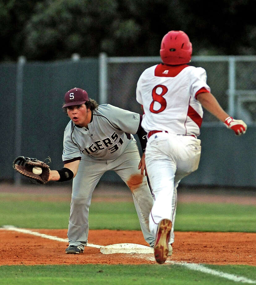 Silsbee first baseman Brayden Griffin, #31, stretches for the out during the Silsbee High School district baseball game against Diboll High School at the University of Houston on Thursday, May 30, 2013. Photo taken: Randy Edwards/The Enterprise Photo: Randy Edwards