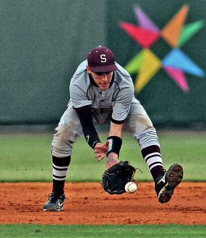 Silsbee second baseman Jordan Gore, #5, fields a ground ball during the Silsbee High School district baseball game against Diboll High School at the University of Houston on Thursday, May 30, 2013. Photo taken: Randy Edwards/The Enterprise