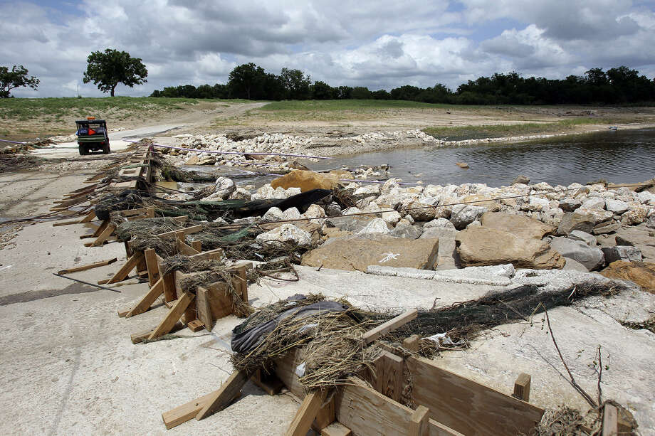 This is some of the damage along the river's Mission Reach area that officials have to contend with. Photo: Tom Reel / San Antonio Express-News