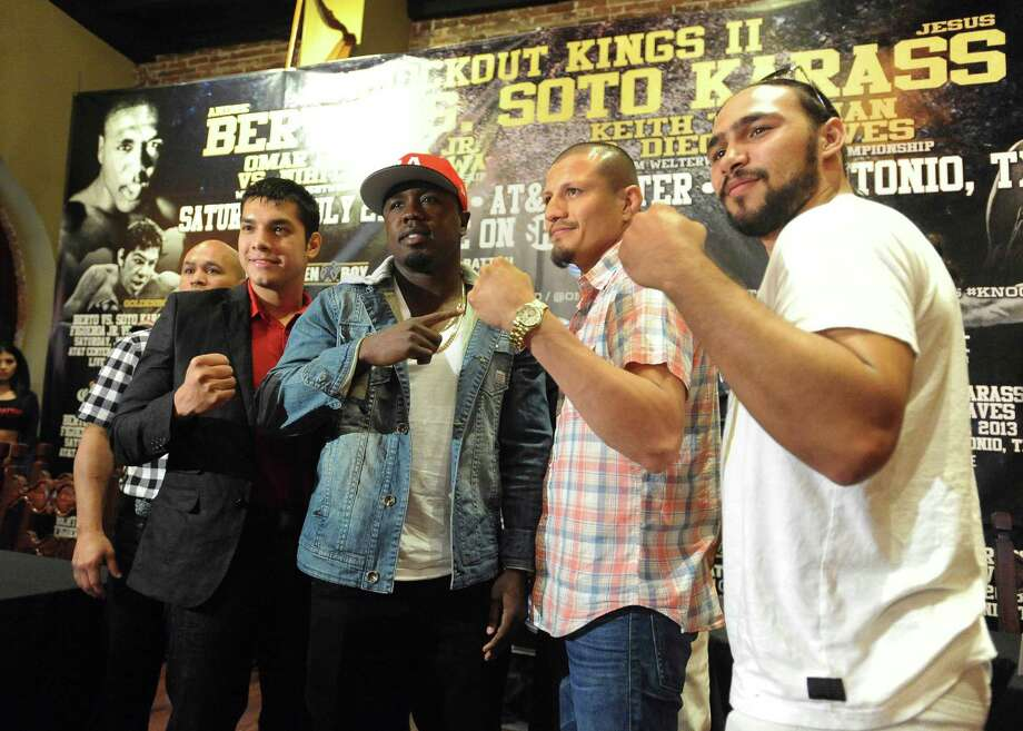 "Promoter ""Jesse"" James Leija, left, stands with boxers Omar Figueroa, Andre Berto, Jesus Soto Karass and Keith Thurman during a press conference at Mi Tierra restaurant on Thursday, May 30, 2013, to promote the ""Knockout Kings II"" boxing event, which will be held at the AT&T Center on July 27. Photo: Billy Calzada, San Antonio Express-News / San Antonio Express-News"