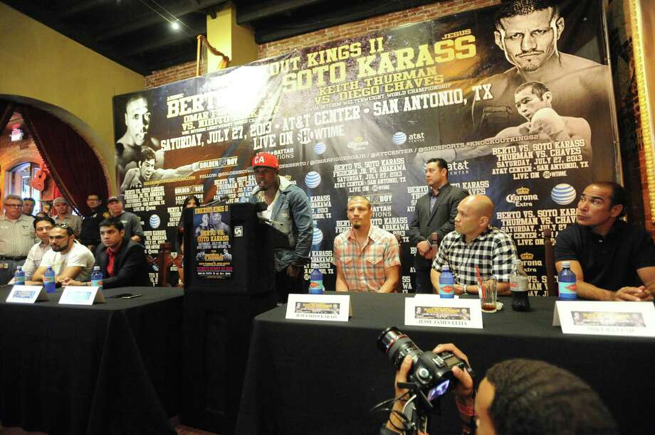 """Boxer Andre Berto speaks during a press conference at Mi Tierra restaurant on Thursday, May 30, 2013, to promote the """"Knockout Kings II"""" boxing event, which will be held at the AT&T Center on July 27. Photo: Billy Calzada, San Antonio Express-News / San Antonio Express-News"""