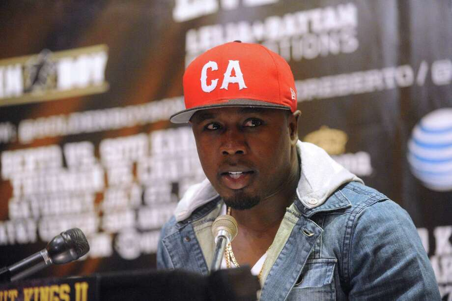 "Boxer Andre Berto speaks during a press conference at Mi Tierra restaurant on Thursday, May 30, 2013, to promote the ""Knockout Kings II"" boxing event, which will be held at the AT&T Center on July 27. Photo: Billy Calzada, San Antonio Express-News / San Antonio Express-News"