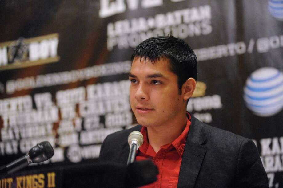 "Boxer Omar Figueroa Jr. speaks during a press conference at Mi Tierra restaurant on Thursday, May 30, 2013, to promote the ""Knockout Kings II"" boxing event, which will be held at the AT&T Center on July 27. Photo: Billy Calzada, San Antonio Express-News / San Antonio Express-News"