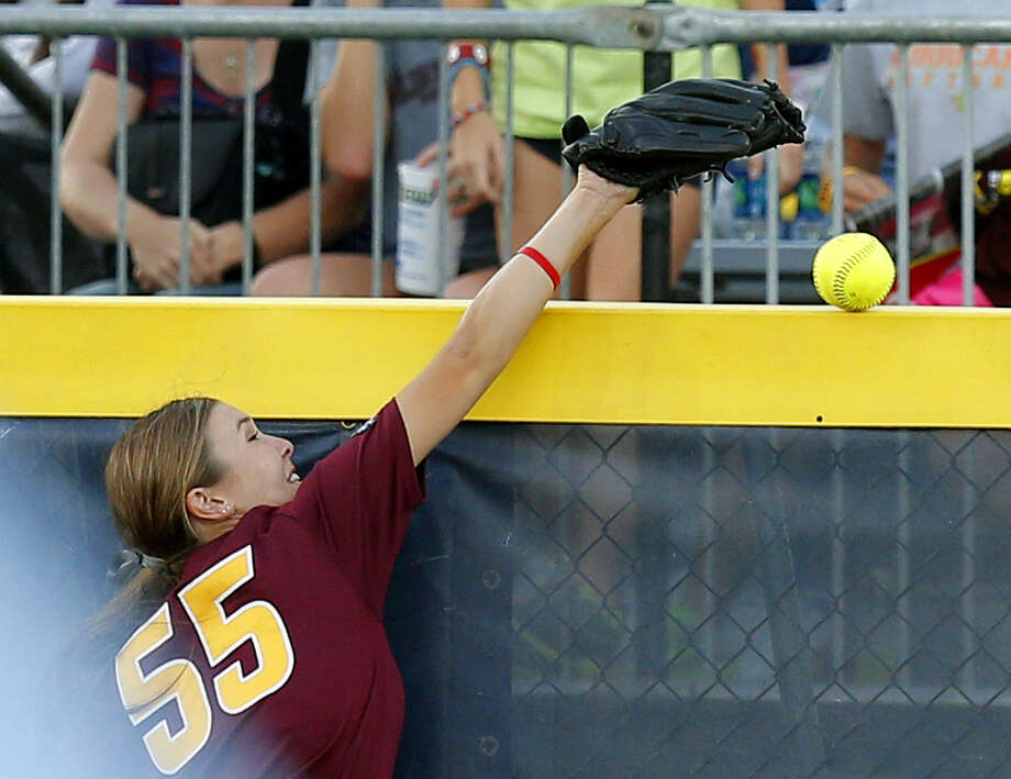 Arizona State's Elizabeth Caporuscio is unable to prevent a ball hit by UT's Kim Bruins from going over the outfield fence for a two-run homer in the fifth inning. The ball initially went off Caporuscio's glove. Photo: Bryan Terry / Associated Press