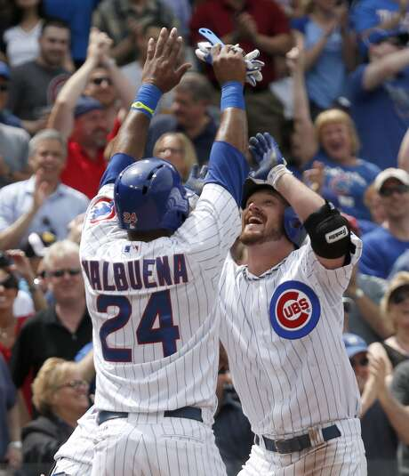 Cubs starter Travis Wood, right, had plenty to celebrate on Thursday, including a grand slam. Photo: Charles Rex Arbogast, STF / AP