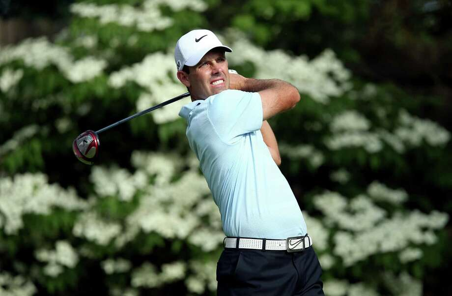 Charl Schwartzel likes what he sees during the first round of the Memorial. He uses two strings of four straight birdies to card a 7-under 65 for a one-shot lead. Photo: Andy Lyons, Staff / 2013 Getty Images