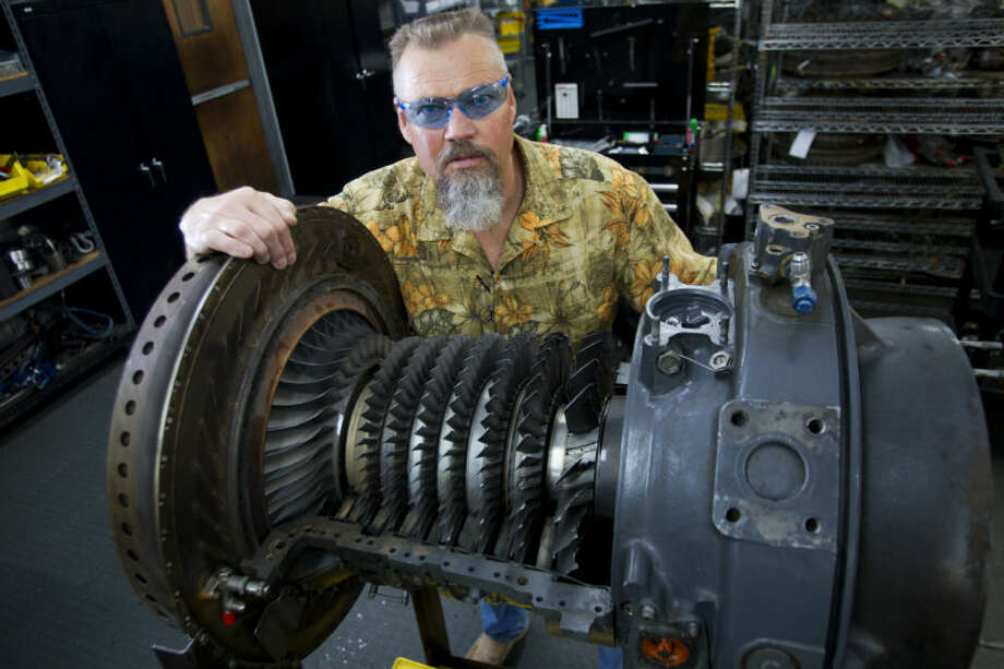 Ted McIntyre, CEO of Turbine Power Technology, stands by a turbine engine from a Chinook helicopter that is being refurbished for use in a hydraulic fracturing. ( Brett Coomer / Houston Chronicle )