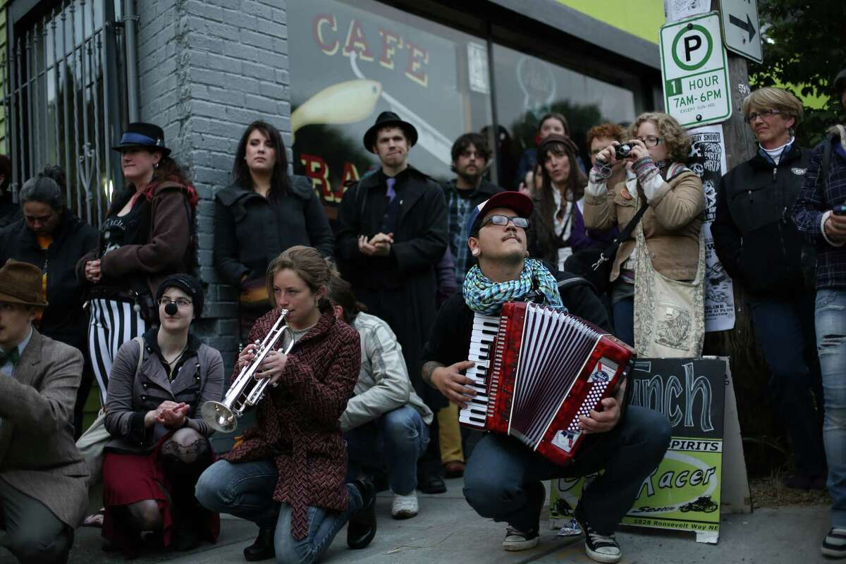 Members of Orkestar Zirkonium perform during a memorial march and concert on Thursday, May 30, 2013, the one year anniversary of the shootings that left four people dead in the popular cafe. Dozens of people marched to music from the band Orkestar Zirkonium from Cafe Racer to nearby Cowen Park.